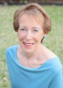 Author photo of Cynthia Levinson again a green grass background.