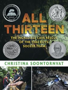 Cover of 'All Thirteen' features a dark green cave scene on top, a picture of rescuers with helmets in a forest pulling on something, and a picture of many flip-flops on a dark rocky surface; four round literary award stickers adorn the cover.