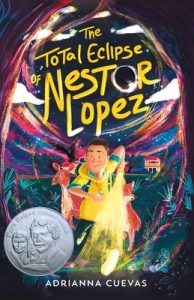 """Cover of """"Total Eclipse of Nestor Lopez"""" features a boy shining a flashlight running into the arched trees of a forest at night, followed by a deer and a fox; a silver Pura Belpre Honor sticker adorns the bottom left corner"""