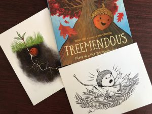 Photo of an illustrated children's book called Treemendous, a signed pen-and-ink print, and a print of an acorn
