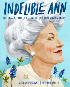 Cover of 'Indelible Ann' features illustrated profile of Ann Richards with white hair and white earring against a sky-blue background speckled with bluebonnet flowers.