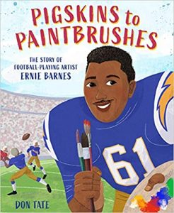 Cover of 'Pigskins to Paintbrushes' features a smiling football player in a blue jersey with number 61 on it, holding three paintbrushes and a palette, against a bakdrop of a football field and stadium where some players are passing the ball.