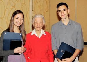Betty X. Davis (c.) honors the winners of the Young Writers of Merit Award.