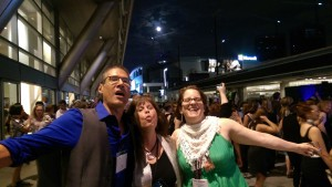 Austin SCBWI author Greg Leitich Smith (l.), Houston author Joy Preble (c.) and MD/DE/WV Region RA Kathy MacMillian shout at the full moon during the Silver Linings Gala at the 2017 SCBWI Summer Conference.