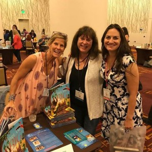 Austin SCBWI Kat Kronenberg (l.) sells her picture book DREAM BIG with author Joy Preble (c.) and AUstin SCBWI RA Samantha M Clark at the 2017 SCBWI Summer Conference.